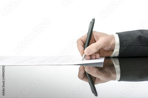 Signing a contract on a black table