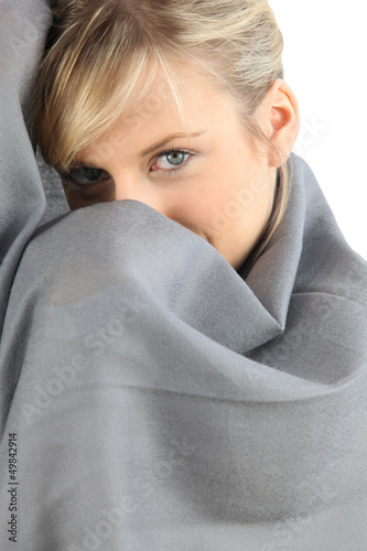 Woman wrapped up in a blanket