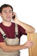 carpenter talking on the phone