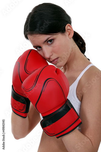 woman wearing red box gloves