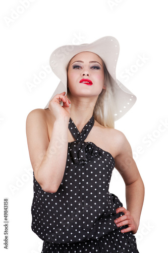 Attractive woman with hat and red lipstick biting her lips