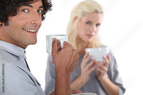 young couple drinking coffee together