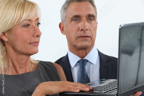Business professionals looking at a website