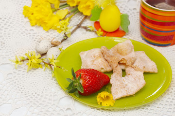 easter decoration with strawberry and eggs