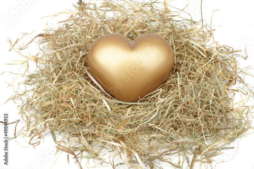 golden heart in a bed from straw