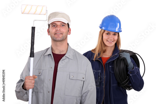 painter with roller and female electrician