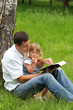 father with baby daughter reading the Bible