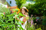 Woman gardener standing in the garden