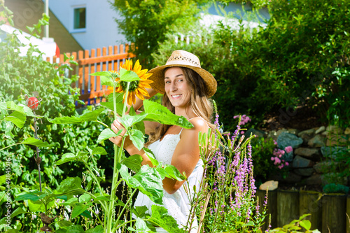 Woman gardener standing in the garden