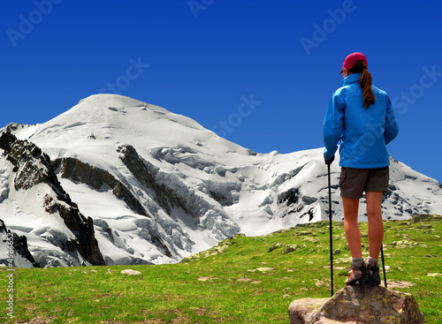 girl looking at the Mont Blanc in the Savoy Alps - France