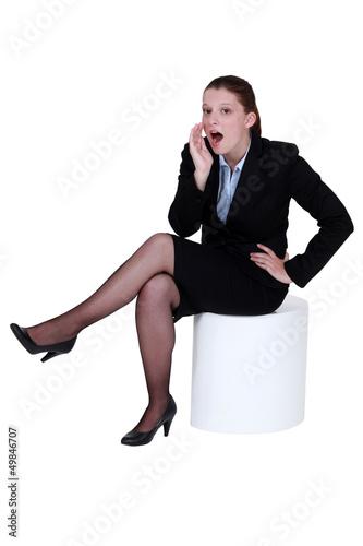 Woman telling a secret.