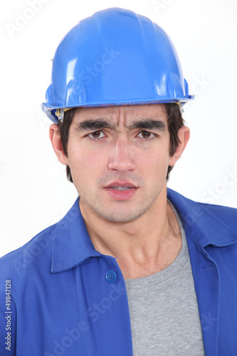 Concerned construction worker