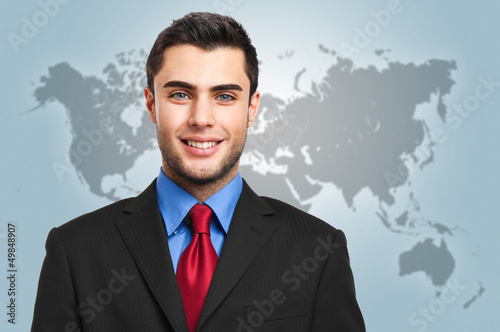 Smiling businessman with the world on the background