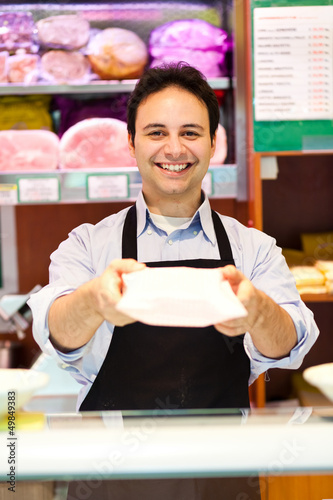 Shopkeeper serving a costumer