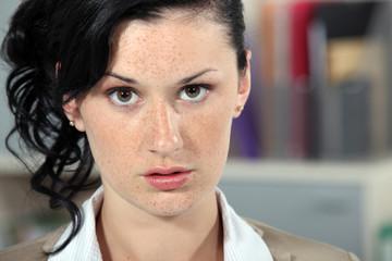 Closeup of a serious young woman