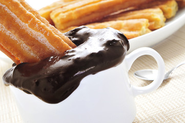 porras, thick churros typical of Spain, dipped in hot chocolate