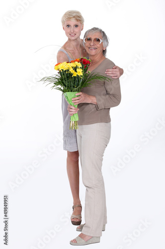 Woman giving her mother flowers