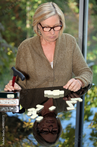 Old woman playing dominos
