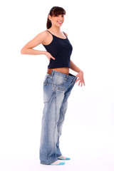 Happy woman in oversized jeans