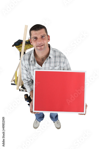 Laborer with red sign isolated on white background
