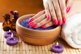Fototapety female hands with aromatic candles and towel. Spa