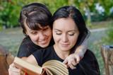 Friends sharing a book