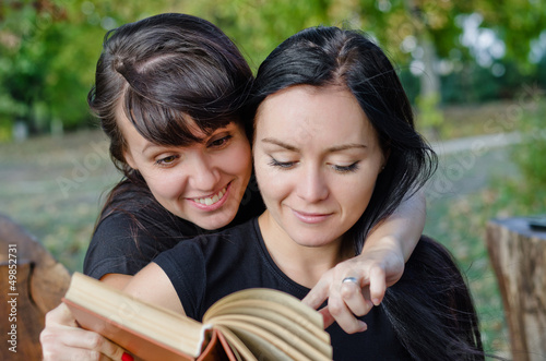 Friends sharing a book
