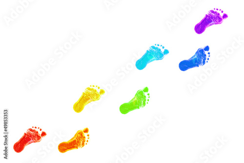 Leinwandbild Motiv Baby foot prints all colors of the rainbow.