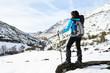 Woman winter mountain hiking