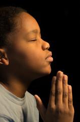 Praying African Americn boy