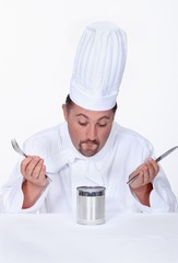 Chef looking at a tin of food