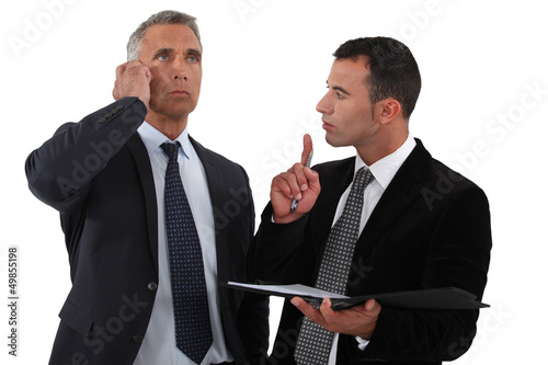 Executives with phone in hand folder