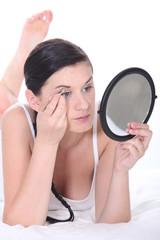 Girl plucking eyebrows