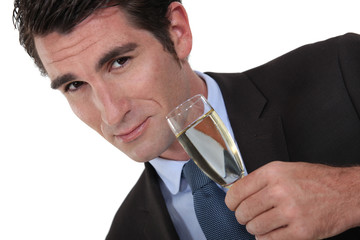 A businessman drinking champagne.