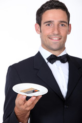 Waiter with a customer's credit card