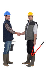 Construction workers handshaking