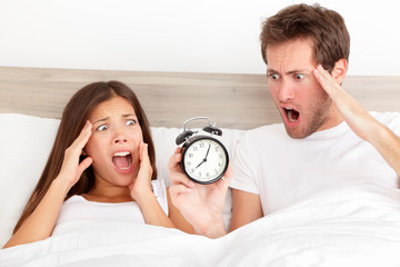 Oversleeping - horrified couple have overslept