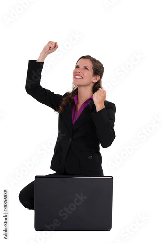 Excited businesswoman with laptop