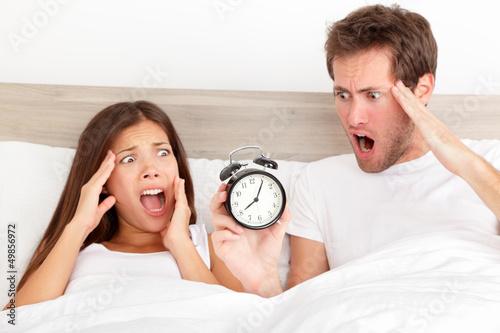 Oversleeping - horrified couple have overslept