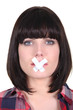 woman with a scotch tape on her mouth
