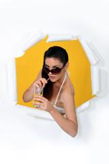 a woman drinking orange juice