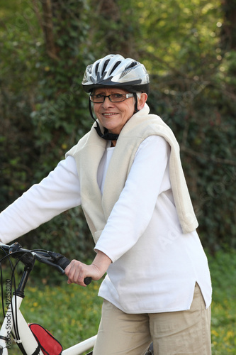 Elderly woman out riding her bike