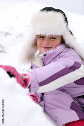 portrait of little girl at ski resort