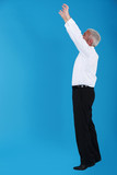 Man stretching to reach an object