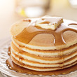 Breakfast food - stack of pancakes with syrup and butter - 49858705