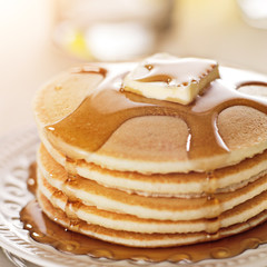 Breakfast food - stack of pancakes with syrup and butter