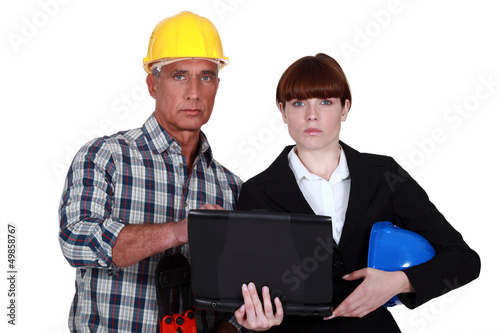 Architect and engineer with a laptop