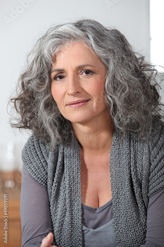 Grey-haired lady sat at home alone