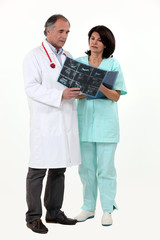 Doctor and nurse looking at x-ray