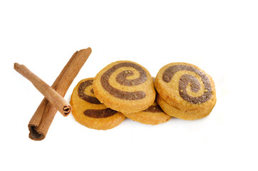 cookies and cinnamon isolated on white